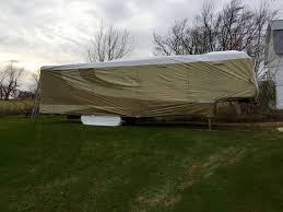 got the toy hauler wrapped up this afternoon special thanks to my lovely wife for being fearless enough to walk the roof and pulling pushing cajoling that
