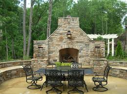 outdoor living area fireplace w seating walls and waterfalls