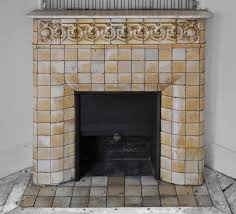 antique art nouveau fireplace ornated with glazed stoneware tiles