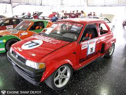 The Justang: A Subaru Justy Wrapped Around a Mustang Cobra ...