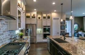 l shape kitchen with white and dark cabinetry contrasts