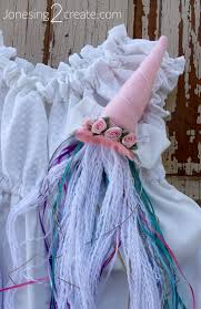 unicorn tail we did the tail in much the same way a mix of ribbons on top and the unraveled yarn on bottom this time i sewed them on to a piece