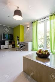 Image Desk 123rfcom Shot Of Spacious Modern Home Office With Green Curtains