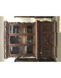 bookcase heavily carved 3 glass doors cabinet dark wood