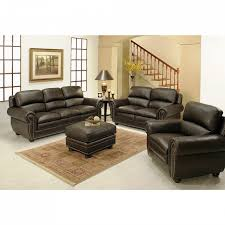 black leather ottoman on rugs and black costco leather sofa plus ikea side table with
