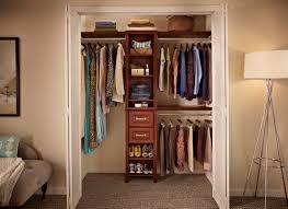 closet design alternative featuring teak wood frames and clothing hanging storage