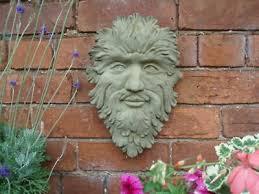 stone garden bearded green man face