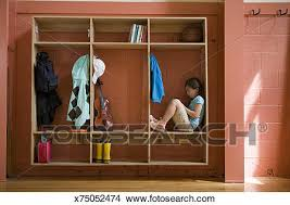 School Coat Rack Stock Photo of Girl 100100 sitting in hallway coat rack in school 55