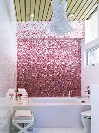 Underneath a lacy Kartell Bloom fixture, pink Bisazza Mosaico tile ...