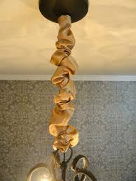 just wrap it around your chandelier chain and secure the velcro the fabric will bunch naturally since it is longer than the chain itself