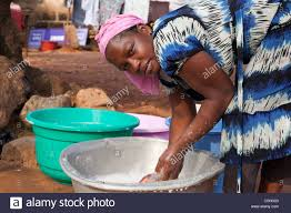 woman washing clothes by hand. Plain Hand Portrait Of An African Woman Washing Clothes By Hand In Buckets Accra  Ghana  Inside Woman Washing Clothes By Hand N