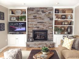 loving this stone veneer fireplace the stacked stone is gorgeous