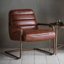 faux leather chair. Chestnut Coloured Faux Leather Chair With Padded Seat And Back Upholstered On A Tubular Antique Brass U