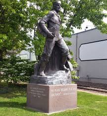 a statue of marcus whitman stands on city property just outside the whitman college campus