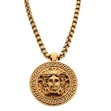 versace medusa logo medallion gold tone