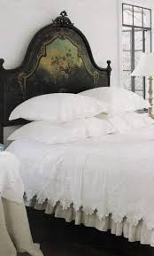 bedroom hand painted headboard with white bedding