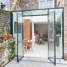 says that modern glass box structures are favoured by english heritage for use on listed buildings as they make a clear distinction between old and new