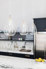 wellington pendant lights hung 3 a line over a kitchen island wellington clear glass pendant light with