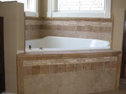 soakertub backsplash custom tile work on a master garden tub in new construction home decor