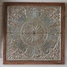 wood framed embossed medallion wall decor