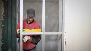 person locking door. Construction Worker Is Working With A Metal Profiles. - 4K Stock Footage Clip Person Locking Door