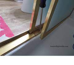 how to fix a sliding shower door guide