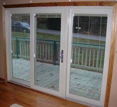 interior view sliding patio door with internal mini blinds