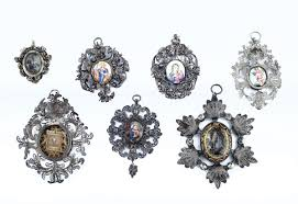 a group of seven pendants with rich silver filigree frames sicilian silverware 18th century