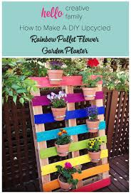 create a bright colorful upcycled rainbow pallet planter project with these simple instructions from hello bedroomeasy eye upcycled pallet furniture ideas