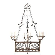 french gothic style nine light vintage iron chandelier with scroll designs for