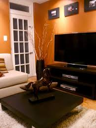 orange walls with brown tan furniture hardwood floors love it all burnt orange living room furniture