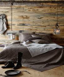 the room is all about the magic of the lighting against the wood wall perfect for smaller rooms 45 cozy rustic bedroom design ideas
