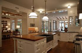 white country kitchen with butcher block. Creamy White Kitchen Cabinets With Stainless Steel Hardware, Glass Front Cabinets, Soapstone Countertops, Subway Tiles, Butcher Block Country