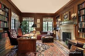 traditional custom home office. traditional home office with custom wood paneling wall sconce crown molding antique limestone