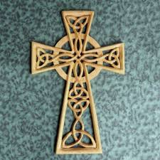 woven trinity knot celtic cross with serch bythol wood carved cross