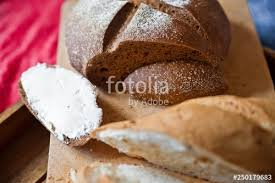 Sliced Baguette And Round Rye Black Bread Sandwich With Bread