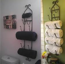 terrific black iron wall mounted towel storage with hook as inspiring classic bathroom storage ideas