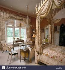 Gothic Style Bedroom Furniture Swagged Curtains On Window In Opulent Bedroom With Silk Drapes On