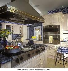 gas stove top cabinet. Stock Photograph Of KITCHENS: Gas Stove Top Area With Stainless Steel Hood, In Ovens On Right. Pickled White Cabinets. Cabinet Z