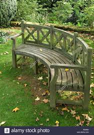 large curved wooden garden bench seat