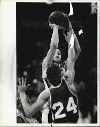 of UIC's Ivan Daniels scoring over W. IL Rick Resetich 1984 Vintage Press  Photo Print | Historic Images