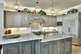 marvelous distressed grey kitchen cabinets with marble top featuring glass pendant lights