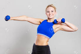 Lifting Light Weights Sporty Woman Lifting Light Dumbbells Weights Fit Girl Exercising