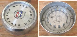 wheel center embly buick motor division written in plastic insert with buick tri shild snaps into 2 hole used pretty nice have 1