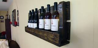 Completed pallet wine rack attached to wall.