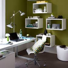 home office shelves. home office with green walls white floating shelves and statement floor lamp