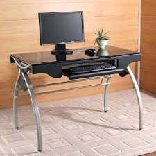computer desk glass top this metal and glass industrial style computer desk features a tempered black glass top arched leg base design keyboard tray and
