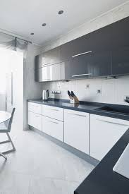 gloss mackintosh kitchen in light grey and white with mirrored black shiny kitchen cabinets