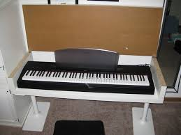 keyboard storage hiding place piano deskfloating