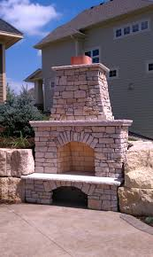 custom outdoor fireplace with our signature two tiered mantel and fond du lac rustic ledgestone